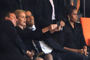 President Obama takes a selfie at a funeral