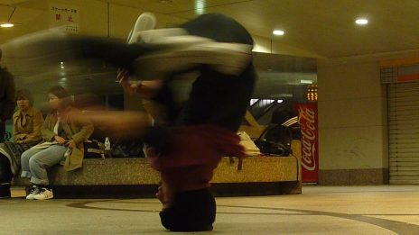 A dancer practicing headspins. Photo taken by Brad Breiten in Osaka, Japan (April, 2011).