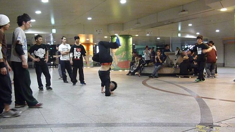A large community breakdance gathering, known as a cypher, where people gather to exchange and show off their skill and ability. Photo taken by Brad Breiten in Osaka, Japan (April, 2011).
